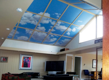Vaulted living room ceiling with trompe l'oeil mural
