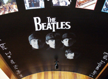 Trompe l'oeil Beatles mural on arched ceiling