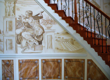 Panoramic trompe l'oeil mural and marbled panels in elegant foyer