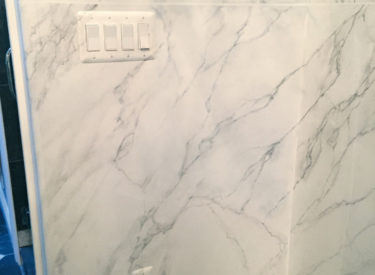 White carrara marbling in master bath