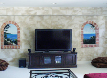 Family room with faux stone and trompe l'oeil mural