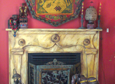 Fauxstone fireplace over original wood