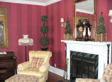 Dramatic striping and faux marbled fireplace